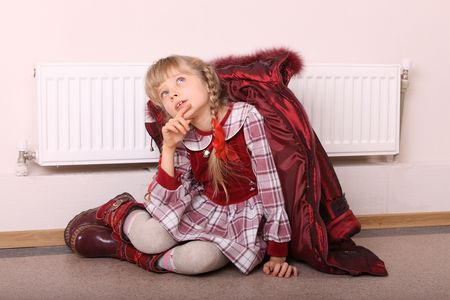 feels: Girl in coat warm  near radiator.  Energy crisis.