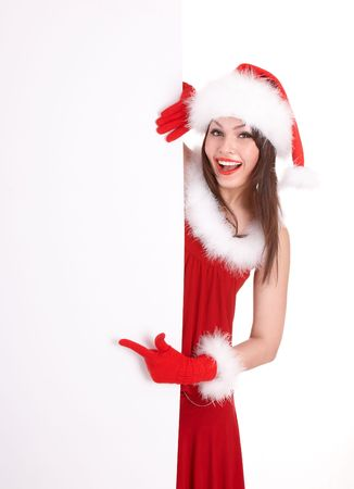Christmas girl in santa hat with banner point. Isolated. photo