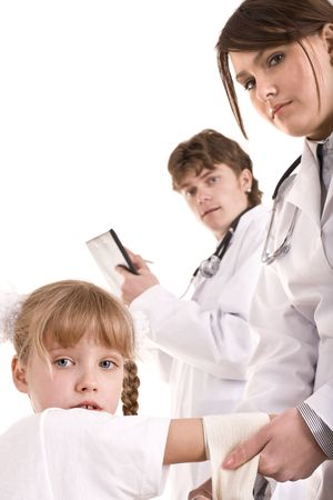 Doctor give first aid of child. Isolated. Stock Photo - 6050274
