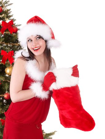 Christmas girl in santa hat, sock, tree.  Isolated. Stock Photo - 6050242