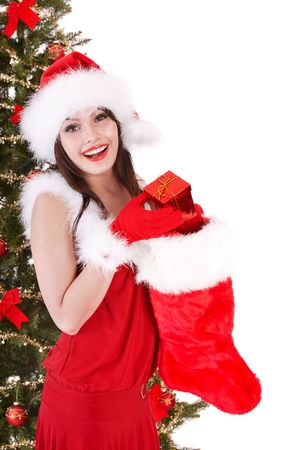 Christmas girl in santa hat,  sock, tree with  gift box. Isolated. photo