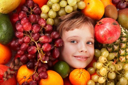 Child girl in group of fruit. Healthcare. Stock Photo - 6050140