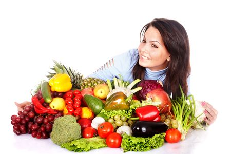 Girl with group of fruit and vegetables. Isolated. Stock Photo - 6050175