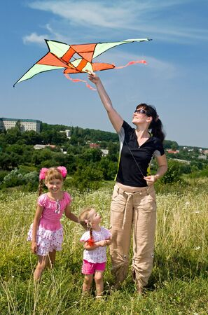 Happy family and children  fly  kite. Outdoor.