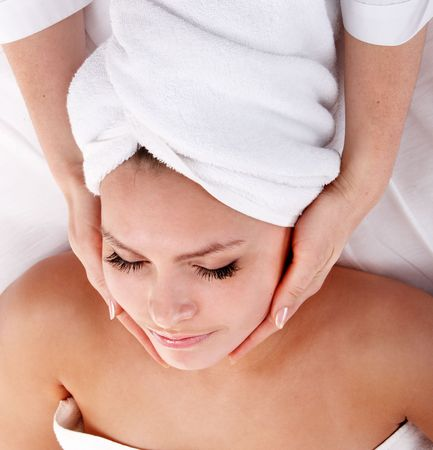Beautiful young woman in spa. Facial massage. Stock Photo