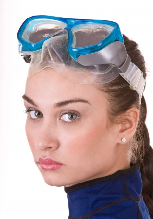 scuba goggles: Beautiful young girl in goggles. Isolated.  Stock Photo