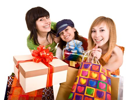 Three beautifu girlfriends enjoy shopping. Isolated. photo