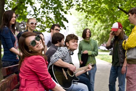 Group of people on city in park. Music. photo