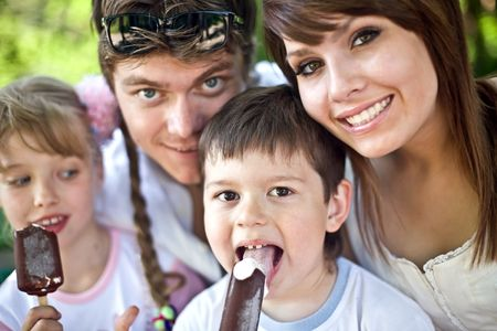 Happy family and group children eat ice cream. Outdoor. Stock Photo - 6207240