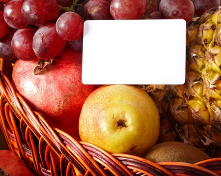 Group of colour fruit in basket with banner.  photo
