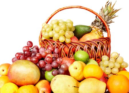 Group of colour fruit in basket. Isolated. photo