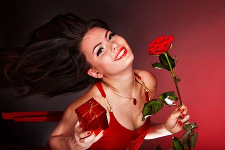 Girl with flower rose and gift box running. Valentines day. Stock Photo - 6283454