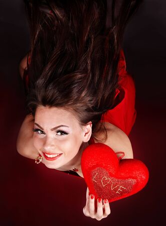 Girl with heart  in red flying.Valentines day. photo