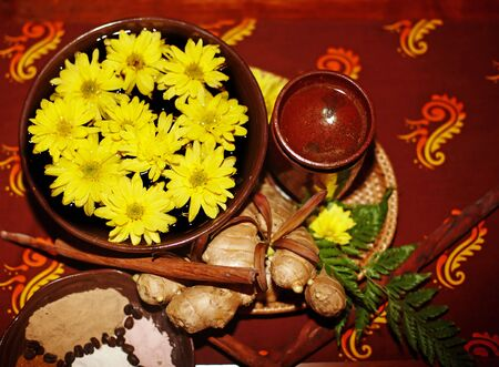 Spa still life with flower and spice on brown background. photo