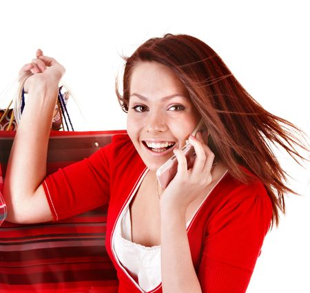 Young woman with shopping bag and mobile telephone. Isolated. photo