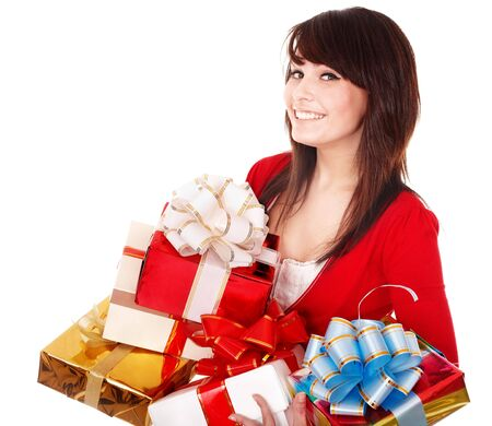 Beautiful girl in red with group of gift box. Isolated. photo