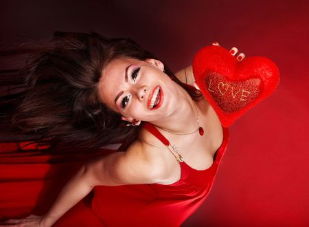 Girl with heart on red background flying. Valentines day. Stock Photo - 6283881