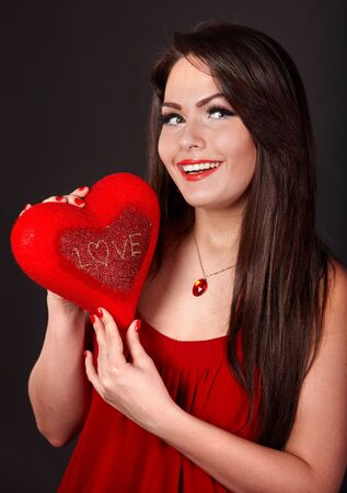 Girl with heart  in red on grey background. Valentines day. Stock Photo - 6281544