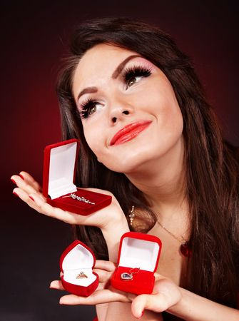 Girl with group jewellery gift box on red  background. Valentines day. photo