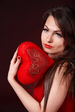 Girl with  heart  on red  background.  Valentines day. Stock Photo - 6281543