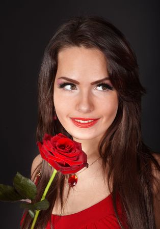 Girl with flower rose on grey background. Valentines day. photo
