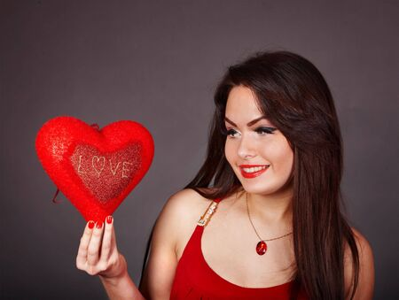 Girl with heart  in red on grey background. Valentines day. Stock Photo - 6283932