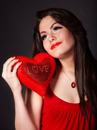 Girl with heart  in red on grey background. Valentines day. Stock Photo - 6283877