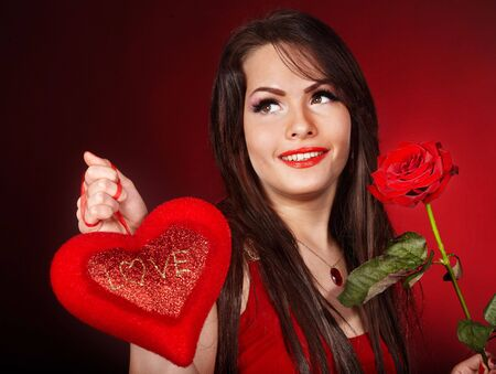 Girl with  heart and flower rose on red  background.  Valentines day. Stock Photo - 6281540