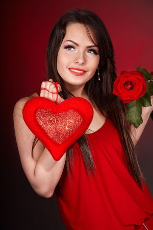 Girl with  heart and flower rose on red  background.  Valentines day. Stock Photo - 6281541