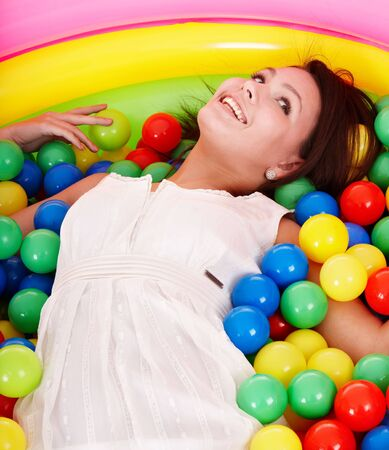 playcentre: Happy birthday of girl in color ball on playground. Stock Photo