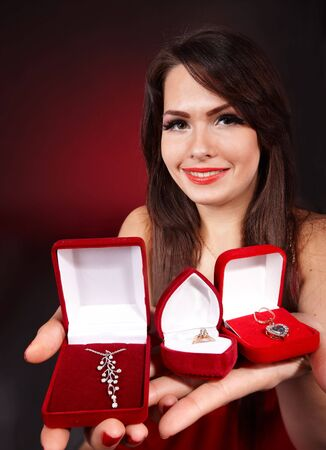 jewellery box: Girl with group jewellery gift box on red background. Valentines day. Stock Photo