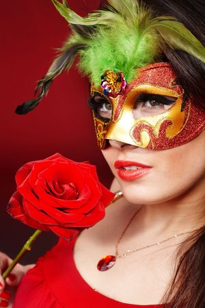 Beautiful girl with red flower rose and mask. Stock Photo - 6346678