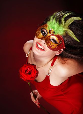 Beautiful girl with red flower rose and mask. Stock Photo - 6345342