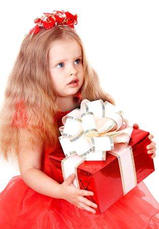 Girl child in red dress with gift box. Isolated. photo