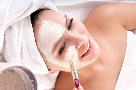 Cosmetician make mask to girl in spa. Facial massage. Stock Photo - 6395599
