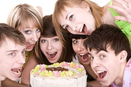 Group of teenagers celebrate birthday. Isolated. photo