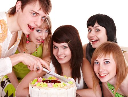 Group of teenagers with cake celebrate happy birthday. Isolated. Stock Photo - 6395699