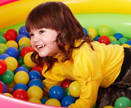 playcentre: Birthday of smiling girl. Group of color ball backgrounds.