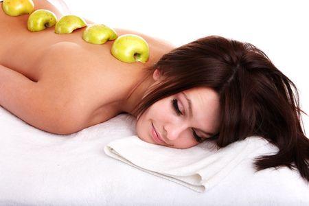 Beautiful girl on spa resort. Exotic fruit massage. photo