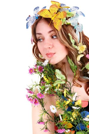 Girl with butterfly and flower on head. Spring hair. Isolated photo