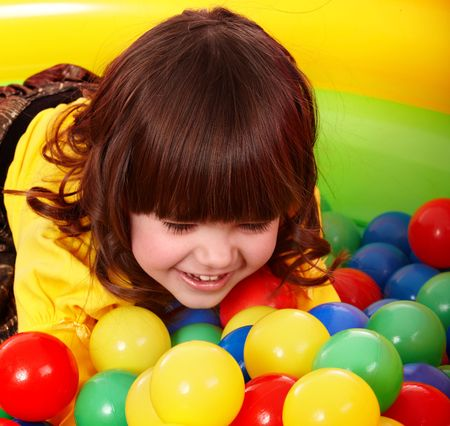 colored play: Little girl with group ball. Play room.