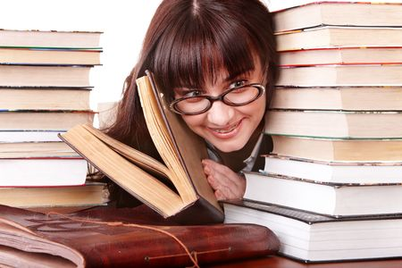 Clever girl in spectacles with group  book.  Isolated. photo