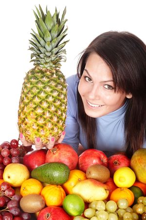 Girl with group of fruit and  pineapple. Isolated. photo