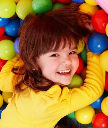 Little girl with group ball. Play room. photo