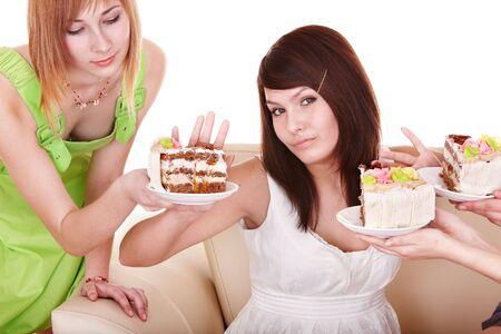 Girl refuse to eat cake. Isolated. photo