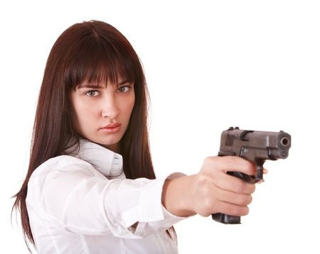 Beautiful young woman with gun. Isolated. photo