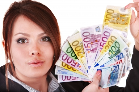 Happy woman with group of money. Isolated. photo