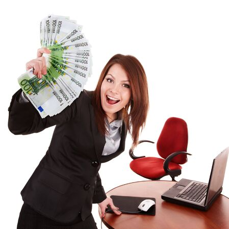 Businesswoman with group of money and laptop. Isolated. photo