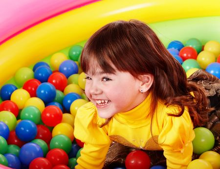 Happy little girl in group colorful ball. Stock Photo - 6758057