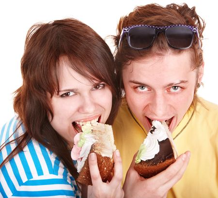 Man  and girl eating cake. Isolated. photo